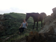 girl and horse on cliff
