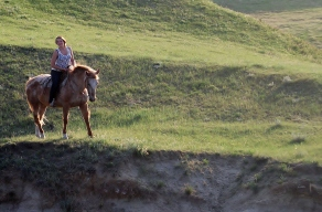 girl riding along cliff