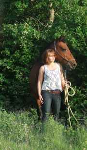 horse and girl in trees