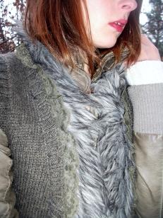 closeup fur trimmed knit vest, leather and lace