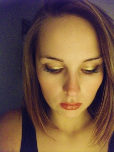use gold eyeshadow to line your upper lash line, and to set red lipstick for a beautiful look