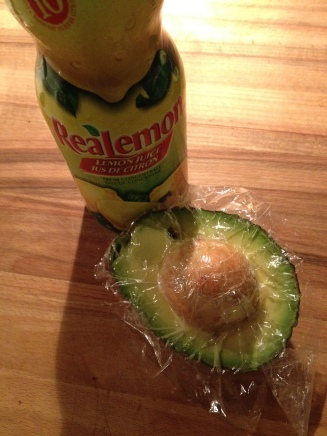 keep avocados green and pretty with lemon juice and saran wrap to seal
