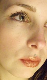 metallic lip color: gold eyeshadow over Revlon Just Bitten Kissable lip balm stain in adore