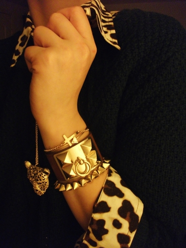accessories -leopard pendant, bracelets - gold cross, arrow, leather cuff, gold studs