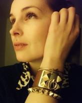 arm candy - vintage arrow bangle, cross chain, leather studded cuff, gold studded bangle
