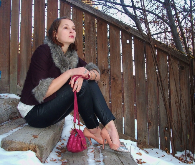 burgundy jacket, grey fur, pink purse and pleather pants