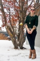 cable knit sweater over printed button down with skinny jeans tucked into boots