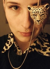 leopard necklace, leopard print top layered under a cable knit sweater
