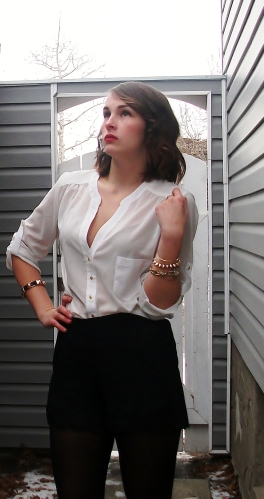 white chiffon button down with gold details, silk black shorts and tights