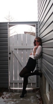 LEAN BACK & RELAX in black platform pumps, black shorts with tights and a classic white blouse