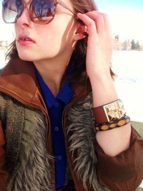 sunglasses, studded leather cuff, carved wooden bangle