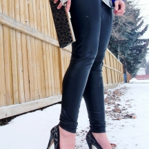 Elephant Ring, Silver leopard print clutch and bow heels.