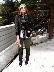 leather jacket layered over a cashmere cardigan, over the knee boots, skull scarf and beanie.