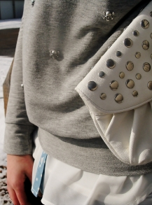 studded white clutch, skull and cross bones embelished knit
