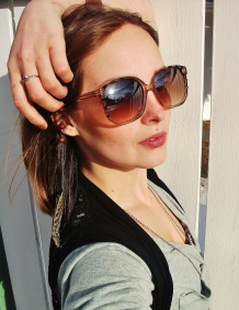 Sunglasses and feather earring by le chateau