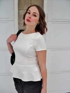 white peplum top, black leather shorts, classic makeup