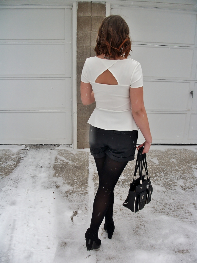 white peplum top with cut out back