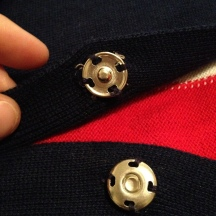 3. closeup of snaps sewn on, 4 holes