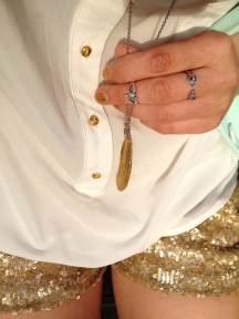 gold feather necklace, turtle knuckle ring, skull ring, gold shorts