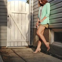 gold sequin shorts, mint blazer