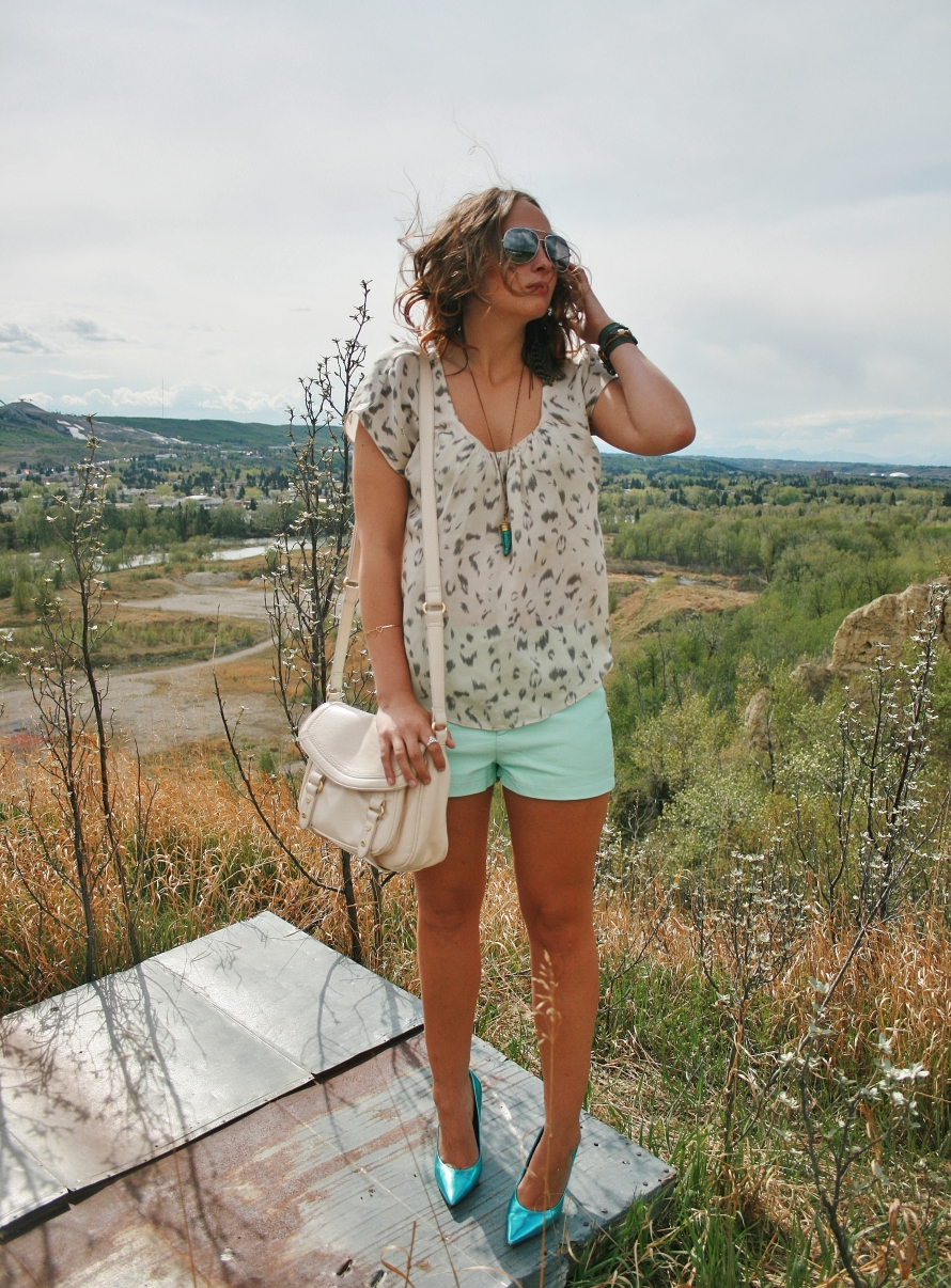 mint shorts, pale leopard shirt