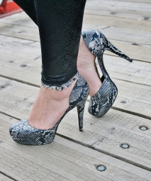 snakeskin leggings and ankle strap pumps